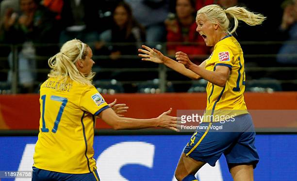 Josefine Oeqvist of Sweden celebrates after scoring her team's first goal with Lisa Dahlkvist during the FIFA Women's World Cup Semi Final match...
