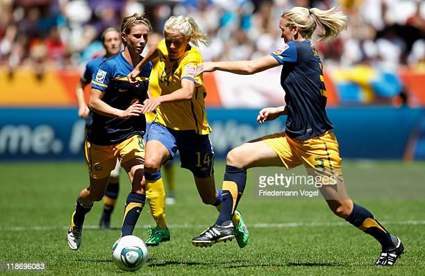 Josefine Oeqvist of Sweden Kim Carroll and Elise KellondKnight of Australia battle for the ball during the FIFA Women's World Cup 2011 Quarter Final...