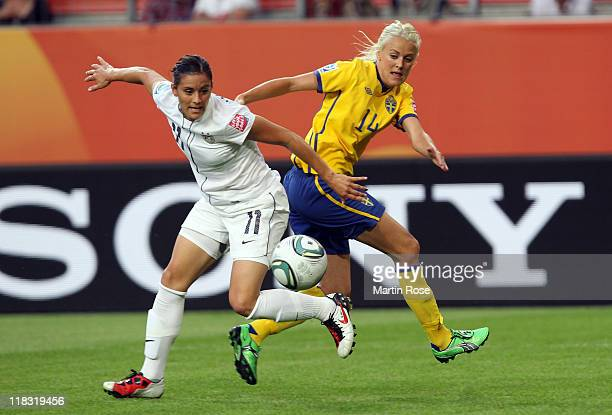 Josefine Oqvist of Sweden and Alex Krieger of USA battle for the ball during the FIFA Women's World Cup 2011 Group C match between Sweden and USA at...