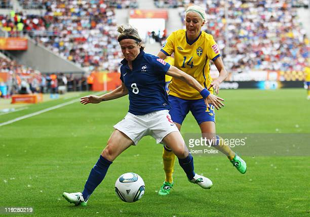Josefine Oqvist of Sweden and Sonia Bompastor of France battle for the ball during the FIFA Women's 3rd Place Playoff match between Sweden and France...