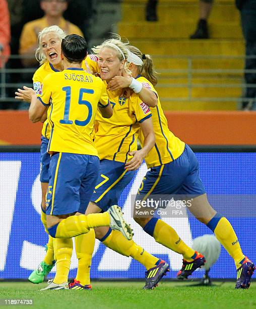 Josefine Oqvist of Sweden celebrates after scoring the first goal against Japan with Lisa Dahlkvist Sara Thunebro and Therese Sjogran during the FIFA...