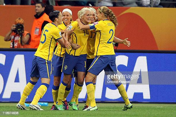 Josefine Oqvist of Sweden celebrates the first goal with Therese Sjogran of Sweden and Charlotte Rohlin of Sweden during the FIFA Women's World Cup...