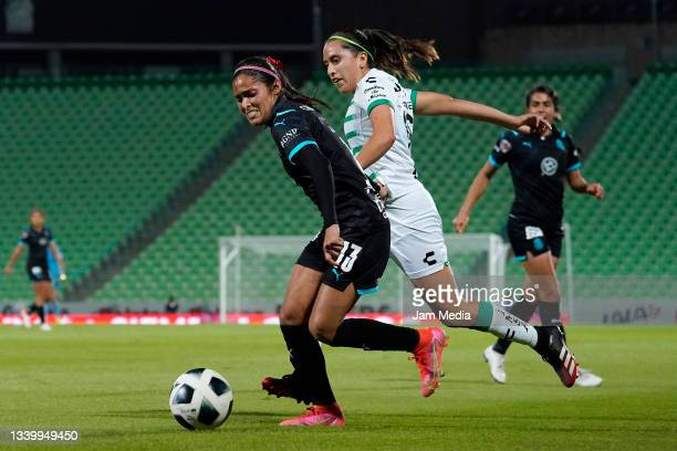 Joseline Montoya of Chivas fights for the ball with Karyme Martinez of Santos during a match between Santos and Chivas as part of the Torneo Grita...