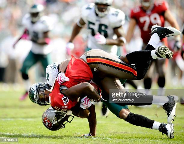 Joselio Hanson of the Philadelphia Eagles tackles Antonio Bryant of the Tampa Bay Buccaneers at Lincoln Financial Field on October 11 2009 in...