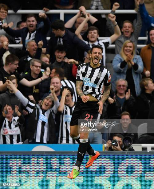 Joselu celebrates after scoring for Newcastle during the Premier League match between Newcastle United and Liverpool at St James Park on October 1...