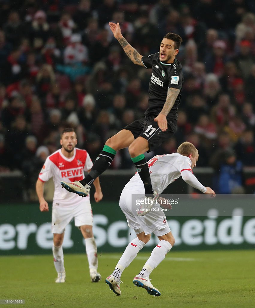 Joselu Mato of Hannover flies over Kevin Vogt of Cologne during the Bundesliga match between 1. FC Koeln and Hannover 96 at RheinEnergieStadion on February 21, 2015 in Cologne, Germany.