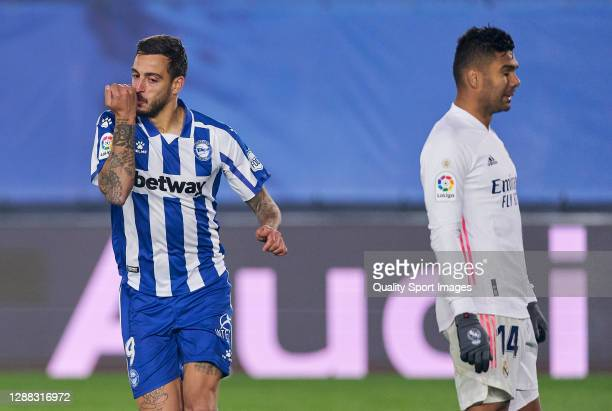 Joselu of Deportivo Alaves celebrates after scoring his team's second goal during the La Liga Santander match between Real Madrid and Deportivo...