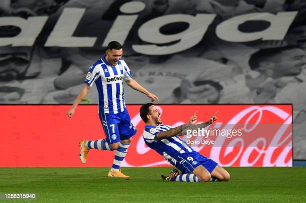 Joselu of Deportivo Alaves celebrates with teammate Lucas after scoring their team's second goal during the La Liga Santander match between Real...