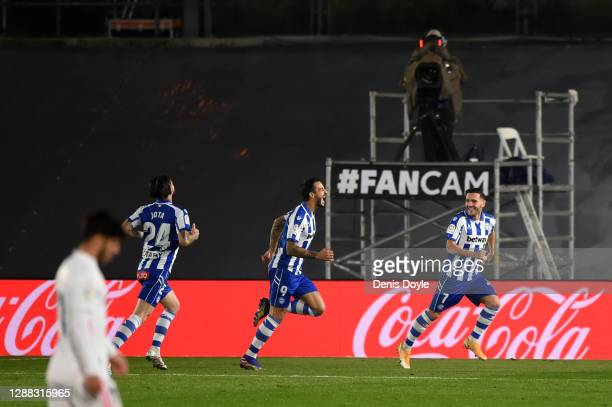 Joselu of Deportivo Alaves celebrates with teammates Jota Peleteiro and Lucas after scoring their team's second goal during the La Liga Santander...