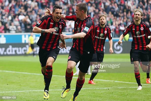 Joselu of Frankfurt celebrates his team's first goal with team mate Alexander Madlung during the Bundesliga match between Eintracht Frankfurt and 1....