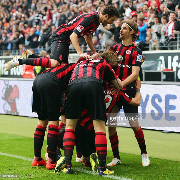 Joselu of Frankfurt celebrates his team's first goal with team mates Tranquillo Barnetta and Martin Lanig during the Bundesliga match between...