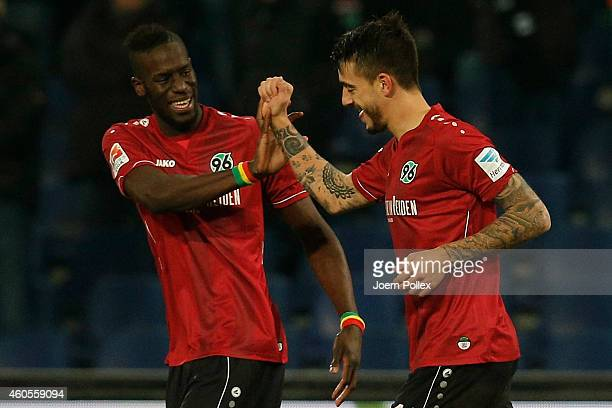 Joselu of Hannover celebrates with his team mate Salif Sane after scoring his team's second goal during the Bundesliga match between Hannover 96 and...