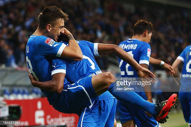 Joselu of Hoffenheim celebrates his team's second goal with team mate Marvin Compper during the Bundesliga match between 1899 Hoffenheim and SpVgg...