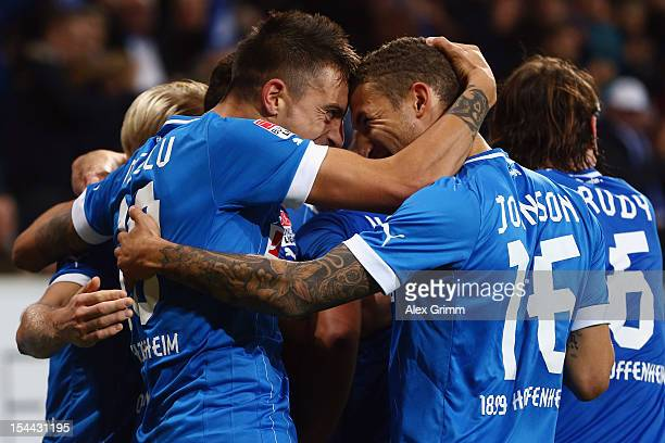 Joselu of Hoffenheim celebrates his team's second goal with team mate Fabian Johnson during the Bundesliga match between 1899 Hoffenheim and SpVgg...