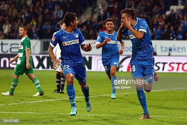 Joselu of Hoffenheim celebrates his team's third goal with team mate Roberto Firmino during the Bundesliga match between 1899 Hoffenheim and SpVgg...