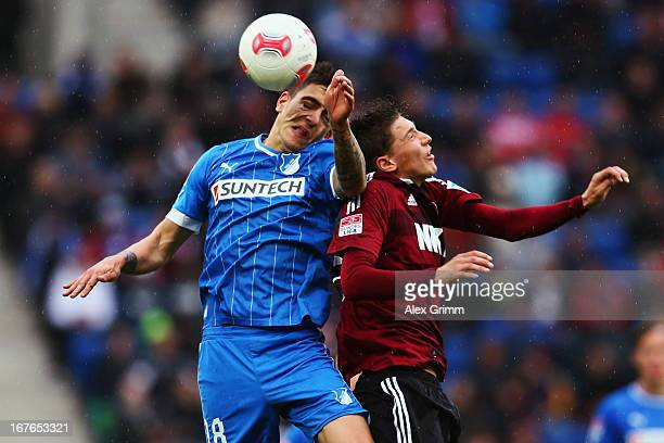 Joselu of Hoffenheim jumps for a header with Niklas Stark of Nuernberg during the Bundesliga match between TSG 1899 Hoffenheim and 1 FC Nuernberg at...