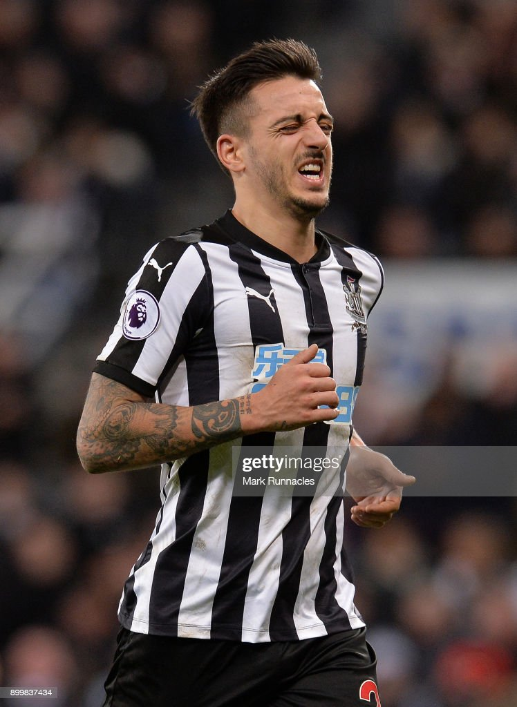 Joselu of Newcastle grimaces as he leaves the pitch during the Premier League match between Newcastle United and Brighton and Hove Albion at St. James Park on December 30, 2017 in Newcastle upon Tyne, England.