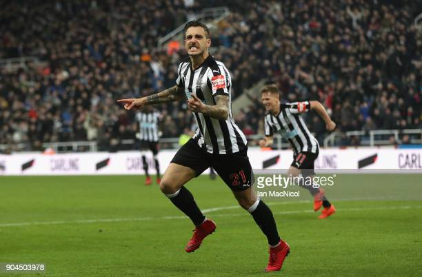 Joselu of Newcastle United celebrates after scoring his sides first goal during the Premier League match between Newcastle United and Swansea City at...
