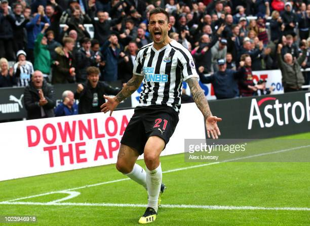 Joselu of Newcastle United celebrates after scoring his team's first goal during the Premier League match between Newcastle United and Chelsea FC at...