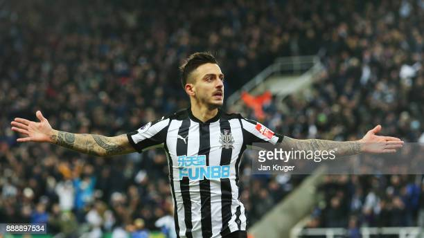 Joselu of Newcastle United celebrates scoring the first goal during the Premier League match between Newcastle United and Leicester City at St James...