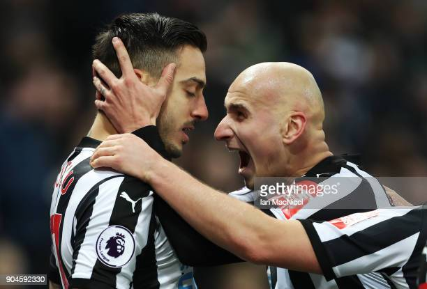 Joselu of Newcastle United celebrates with Jonjo Shelvey after he scores his team's first goal during the Premier League match between Newcastle...