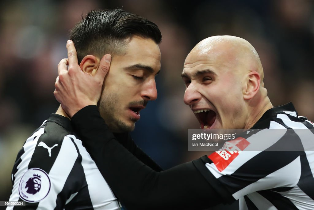 Joselu of Newcastle United celebrates with Jonjo Shelvey after he scores his team's first goal during the Premier League match between Newcastle United and Swansea City at St. James Park on January 13, 2018 in Newcastle upon Tyne, England.