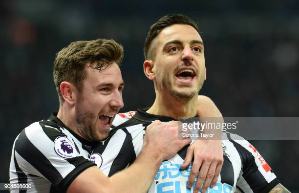 Joselu of Newcastle United celebrates with Paul Dummett after he scores the equalising goal during the Premier League match between Newcastle United...