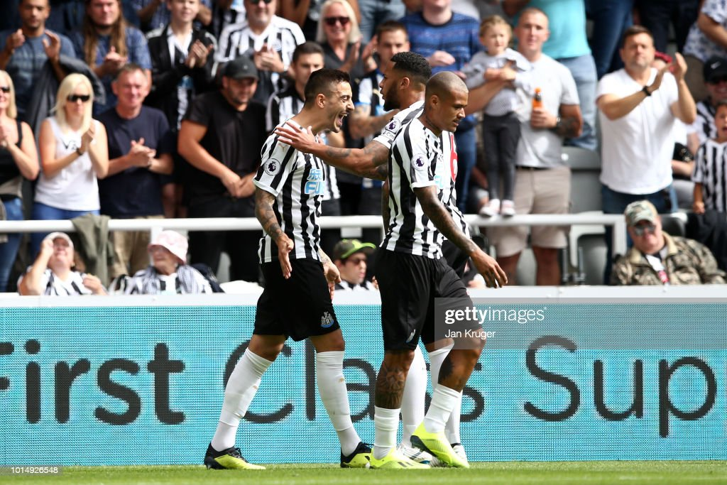Joselu of Newcastle United celebrates with teammates after scoring his team's first goal during the Premier League match between Newcastle United and Tottenham Hotspur at St. James Park on August 11, 2018 in Newcastle upon Tyne, United Kingdom.