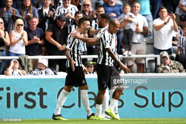 Joselu of Newcastle United celebrates with teammates after scoring his team's first goal during the Premier League match between Newcastle United and...