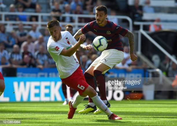 Joselu of Newcastle United has his shot blocked by Jeffrey Gouweleeuw of FC Augsburg during the PreSeason Friendly match between Newcastle United and...