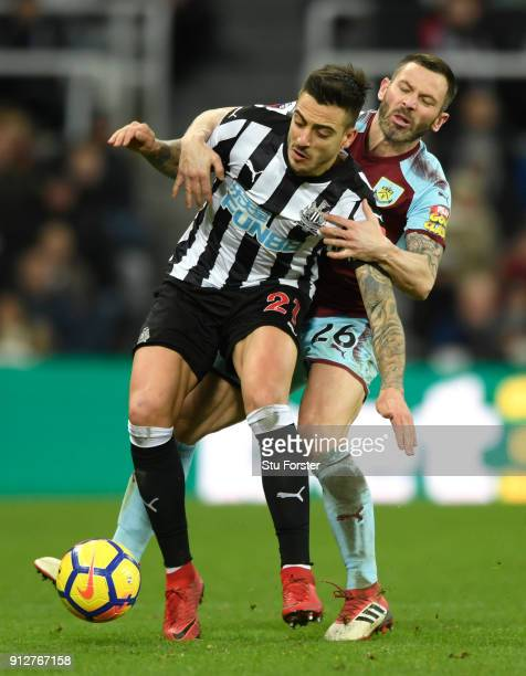 Joselu of Newcastle United is challenged by Phil Bardsley of Burnley during the Premier League match between Newcastle United and Burnley at St James...