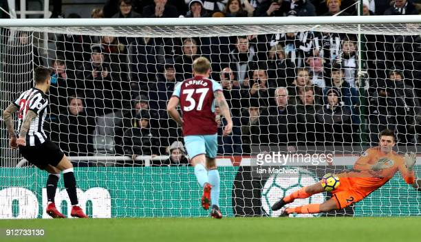Joselu of Newcastle United misses a penalty kick saved Nick Pope of Burnley during the Premier League match between Newcastle United and Burnley at...