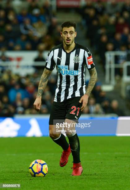 Joselu of Newcastle United runs with the ball during the Premier League match between Newcastle United and Brighton and Hove Albion at StJames' Park...