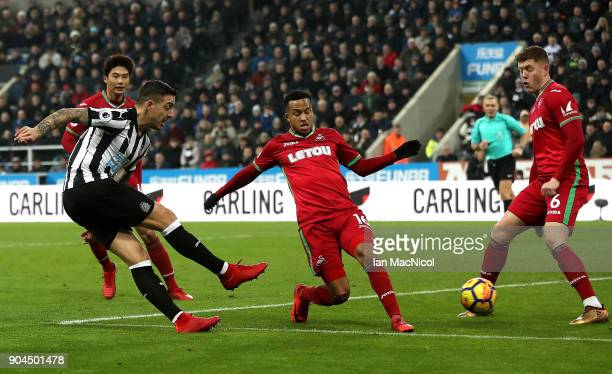 Joselu of Newcastle United scores his sides first goal during the Premier League match between Newcastle United and Swansea City at St James Park on...