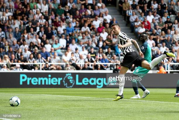 Joselu of Newcastle United scores his team's first goal during the Premier League match between Newcastle United and Tottenham Hotspur at St James...