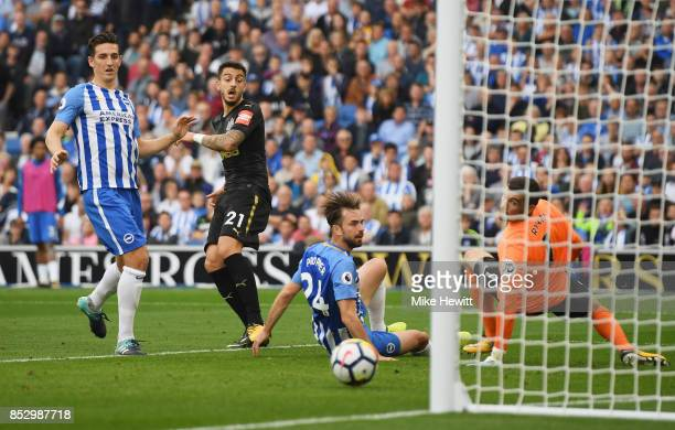 Joselu of Newcastle United shoots past Davy Propper and Mathew Ryan of Brighton and Hove Albion but misses during the Premier League match between...