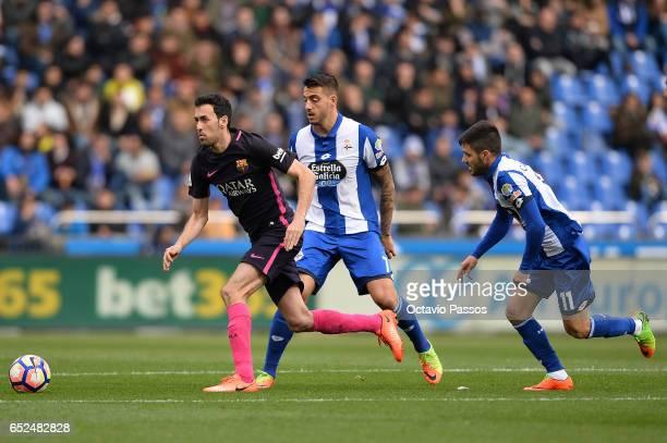 Joselu of RC Deportivo La Coruna competes for the ball with Sergio Busquets of FC Barcelona during the La Liga match between RC Deportivo La Coruna...