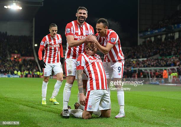 Joselu of Stoke City celebrates scoring his team's second goal with his team mates Ibrahim Afellay Jonathan Walters and Peter Odemwingie of Stoke...