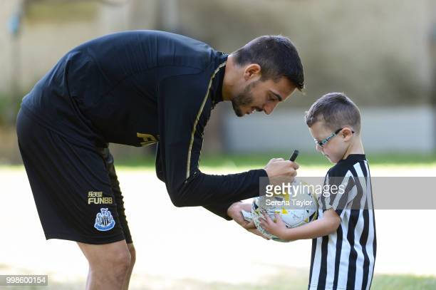 Joselu signs a young fans football during the Newcastle United Training session at Carton House on July 14 in Kildare Ireland