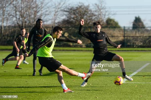 Joselu strikes the ball past Kelland Watts during the Newcastle United Training Session at The Newcastle United Training Centre on November 15 in...