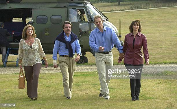 JoseMaria Aznar the Spanish Prime Minister and his wife Anna Botella walk with his British opposite number Tony Blair and wife Cherie after the...