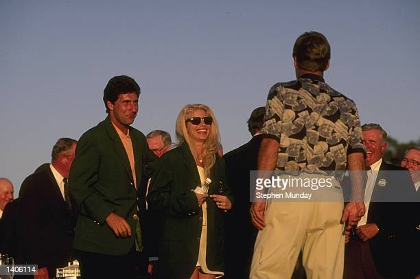 JoseMaria Olazabal of Spain and Ben Crenshaw of the USA watch as Ben''s wife Julie tries on his green jacket after his victory in the US Masters at...