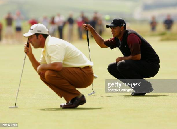 Jose-Maria Olazabal of Spain and Tiger Woods of the USA line up their putts on the sixth green during the final round of the 134th Open Championship...
