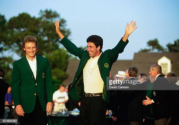 Jose-Maria Olazabal of Spain celebrates his victory after being presented with the green jacket as Bernhard Langer of Germany looks on after the...
