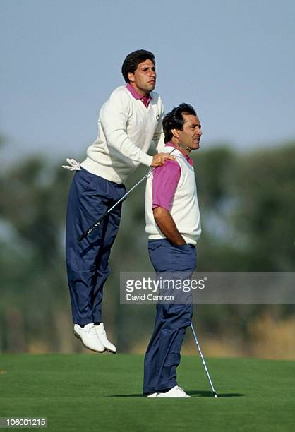 Jose-Maria Olazabal of Spain uses the shoulders of Seve Ballesteros also of Spain to get a better view during the 29th Ryder Cup Matches on 28th...
