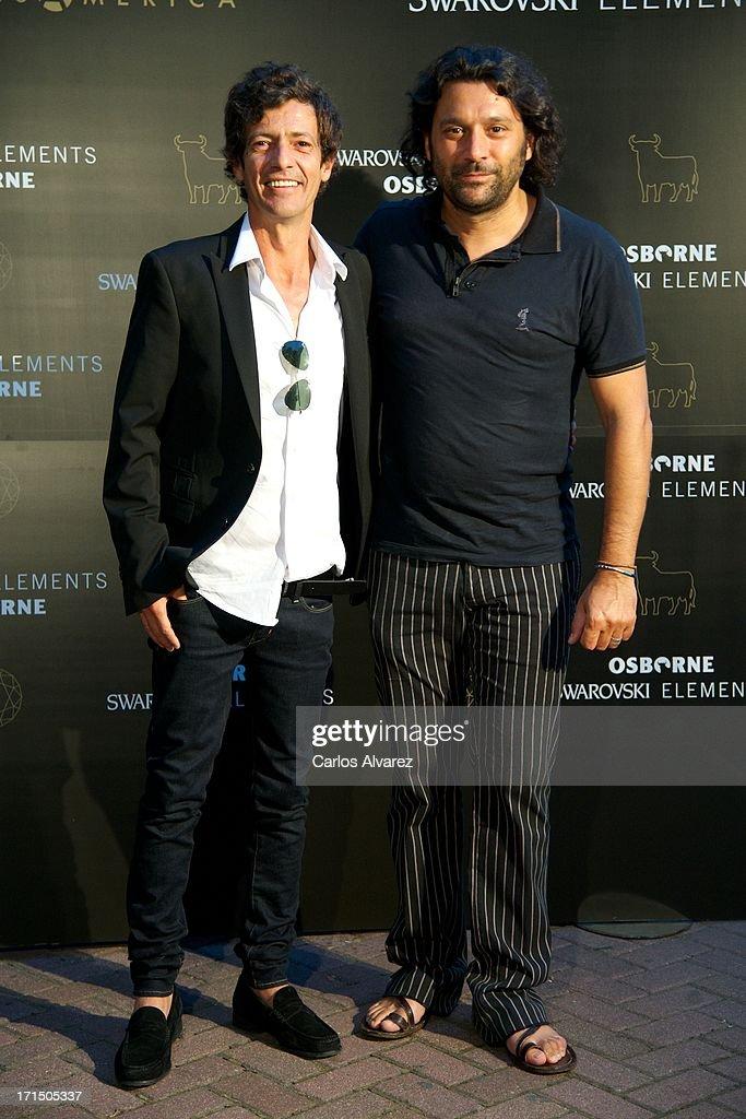 Josemi Carmona (R) and Willie Marquez (L) attend Swarovski-Osborne Bull illumination at the Casa America on June 25, 2013 in Madrid, Spain.