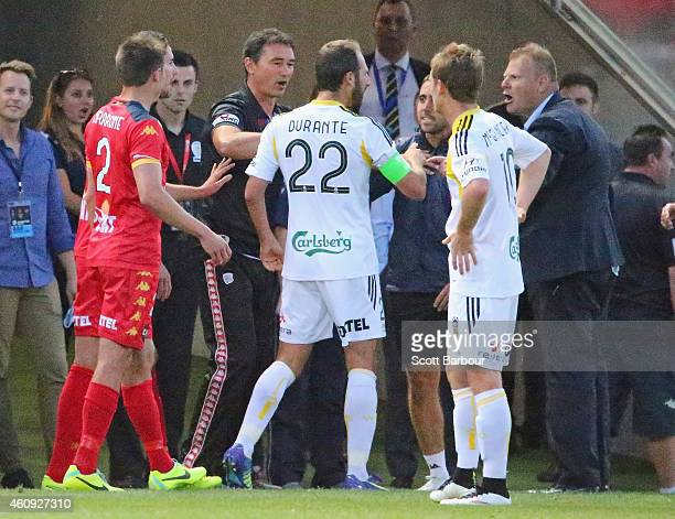 Josep Gombau coach of Adelaide United leaves his area to argue with Andrew Durante of the Phoenix during the round 14 ALeague match between Adelaide...