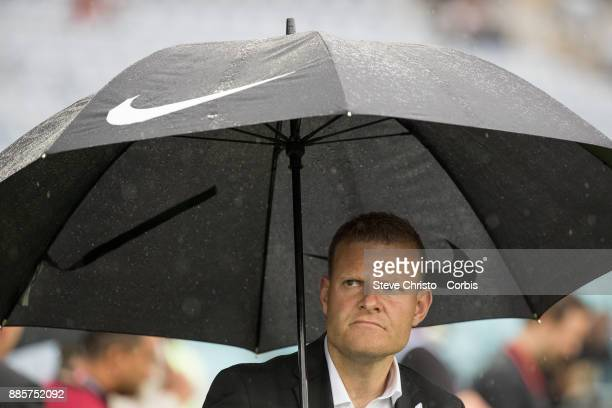 Josep Gombau of the Wanderers watches his team warm up under an umbrella during the round nine ALeague match between the Western Sydney Wanderers and...