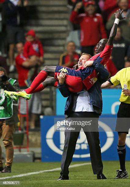 Josep Gombau United head coach celebrates with Awer Mabil of United during the round 26 ALeague match between Adelaide United and Melbourne Heart at...