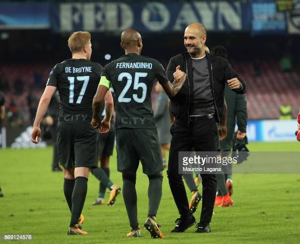 Josep Guardiola and Fernandinho of Manchester City celebrate after the UEFA Champions League group F match between SSC Napoli and Manchester City at...